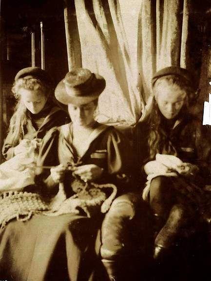Alexandra crocheting with Olga and Tatiana.