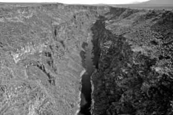 The Rio Grande Gorge in stark black and white...but at sunset?  Watch out.  So gorgeous, and famous -- starts in Northern NM and runs to Mexico.  A frequent film star, http://taos.org/html-assets/file/TaosintheMovies_online11_29.pdf