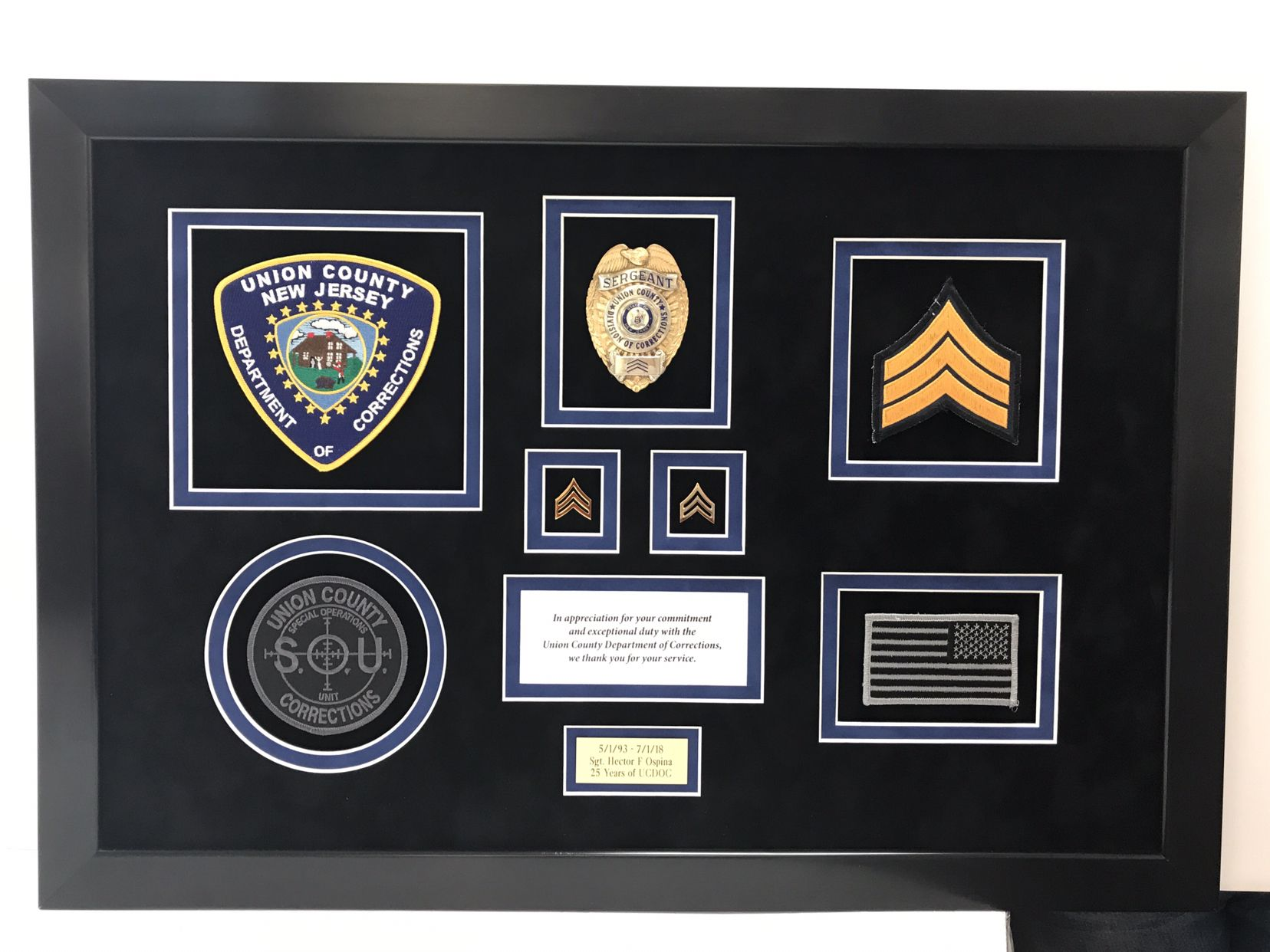 Framed law enforcement retirement gift. Containing patches