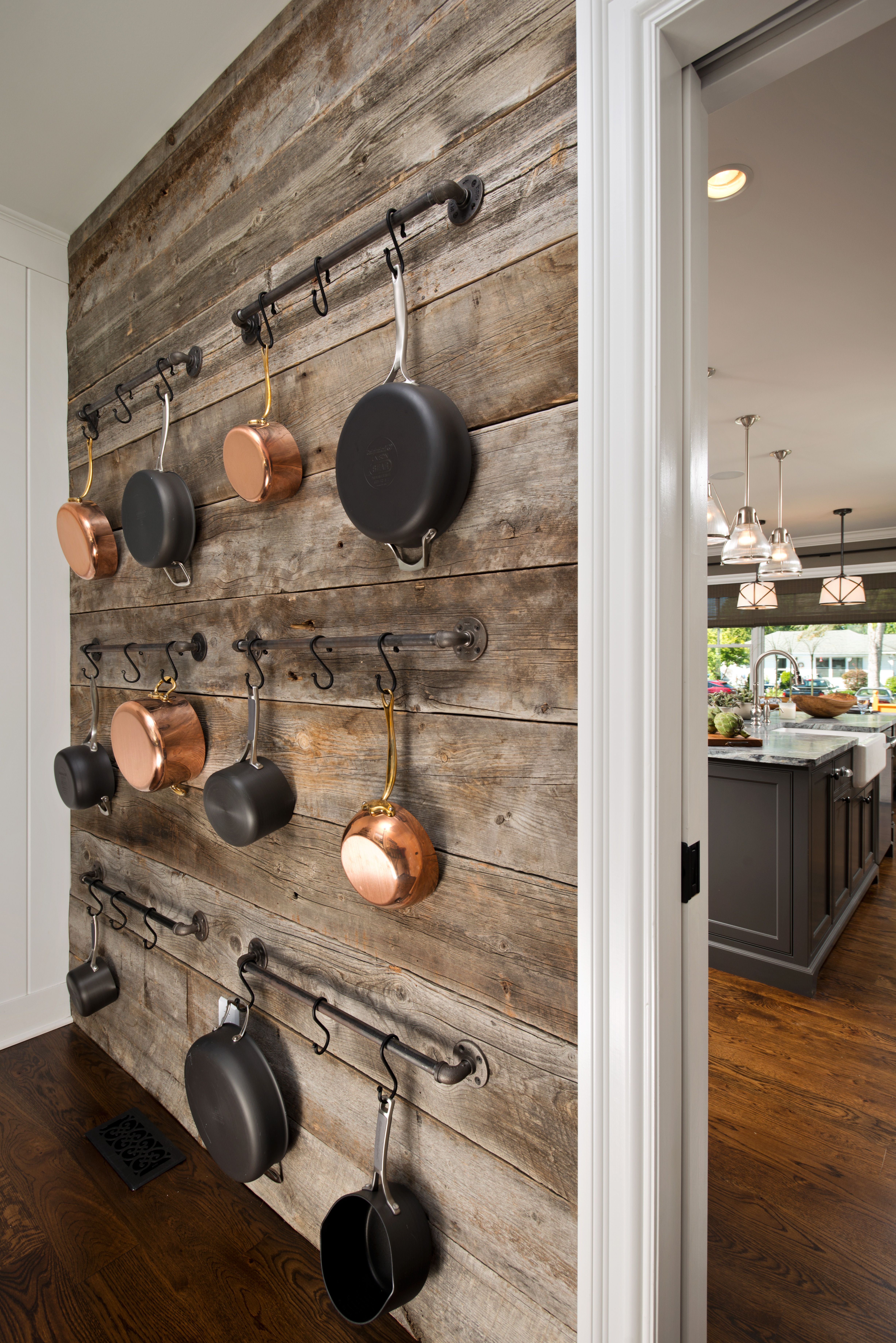 Award homes with images accent wall in kitchen