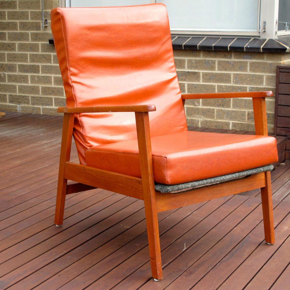 Original locally made 1960s recliner back armchair in wood orange vinyl