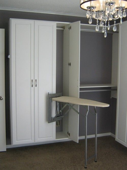 California Closet Ironing Board Looks Complicated Wonder If They Have Updated Closet Storage Design Laundry Room Design Modern Closet