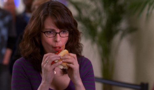 Liz: Leave the sandwich? Leave the sandwich?  Final boarding call for Flight 254 to Cleveland.  Security Woman: You're choosing a sandwich over a guy? Hmm. That is less clichéd.  Liz: I can do it.  I can have it all!  Security Woman: God, lady, you're eating foil!
