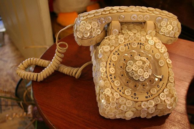 Vintage telephone covered in buttons!