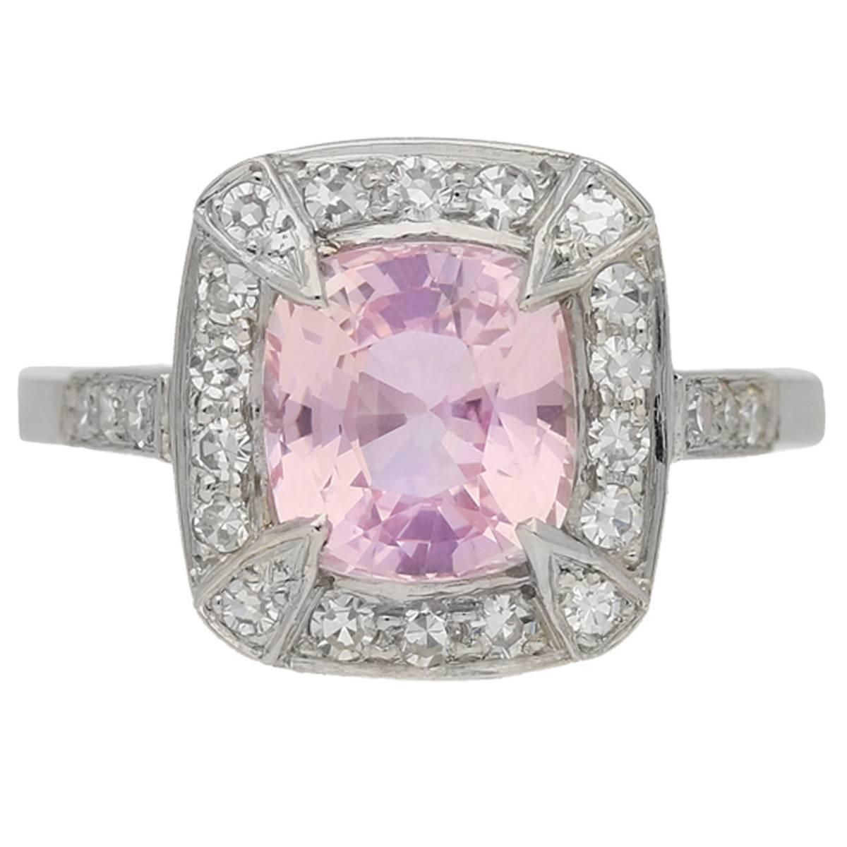 Natural untreated padparadscha sapphire and diamond cluster ring