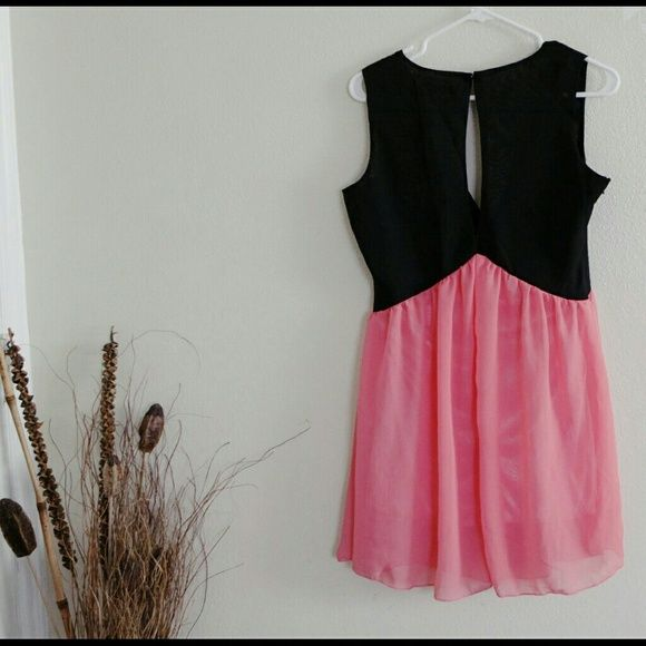 Mix & Match SALE  Dress Sheer material. BRAND New With tag. Picture 3 showing a flaw from the dress. It has small portion of fabric not stitched evenly. Just a trim will do fine. LAST PICTURE is from the internet, just an idea how it looks in person. True color is black and pink. Dresses