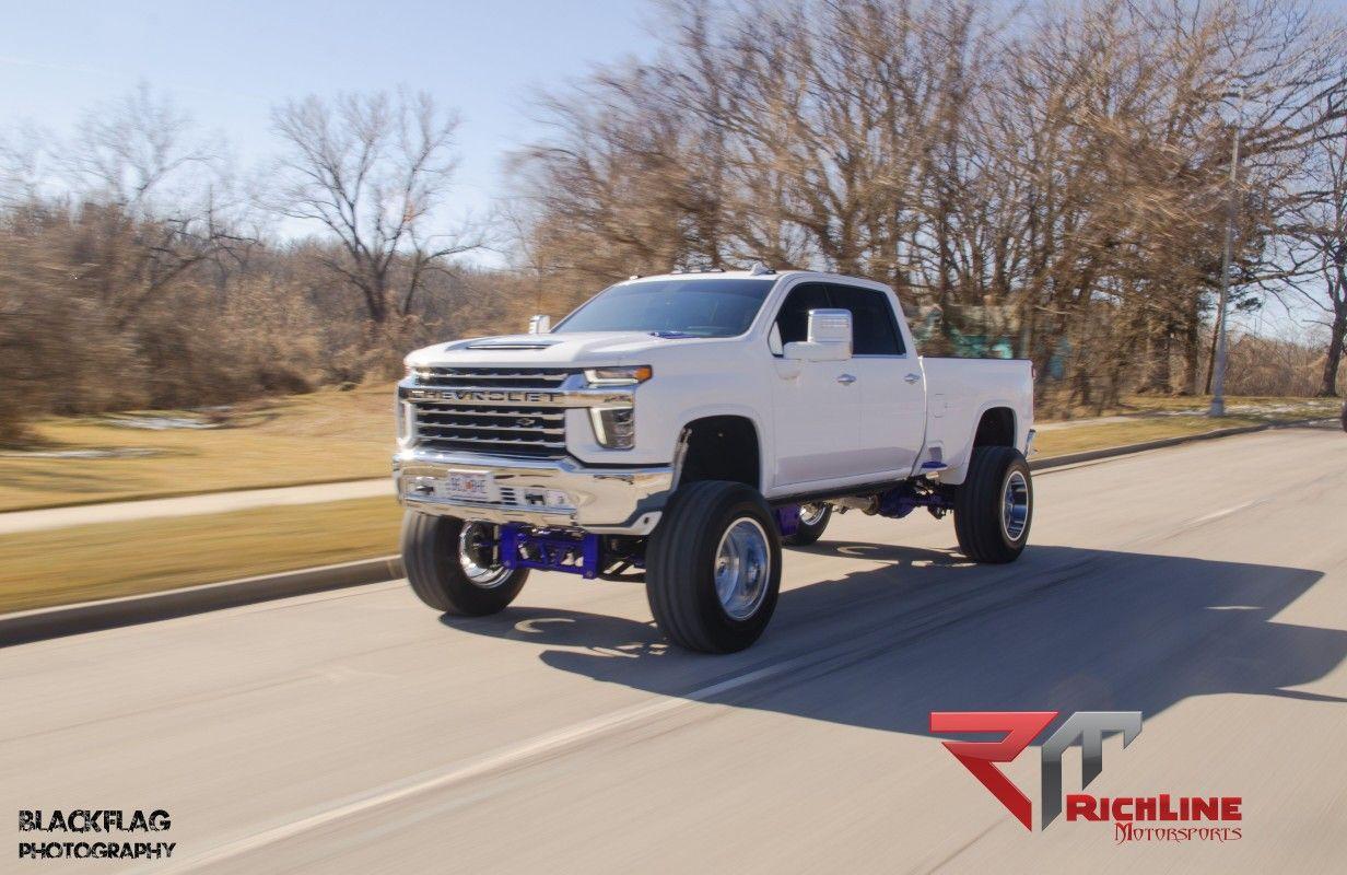 2020 Chevy 2500 12 Bulletproof Lift 24x14 Tis 544 Chrome Wheels 40x1550 24 Nitto Trail Grappler Tir In 2020 Chrome Wheels Chevy Bulletproof