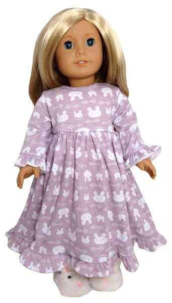 This is a sweet nightie with bunnies and ruffles.  It fastens at the back with a Velcro strip.