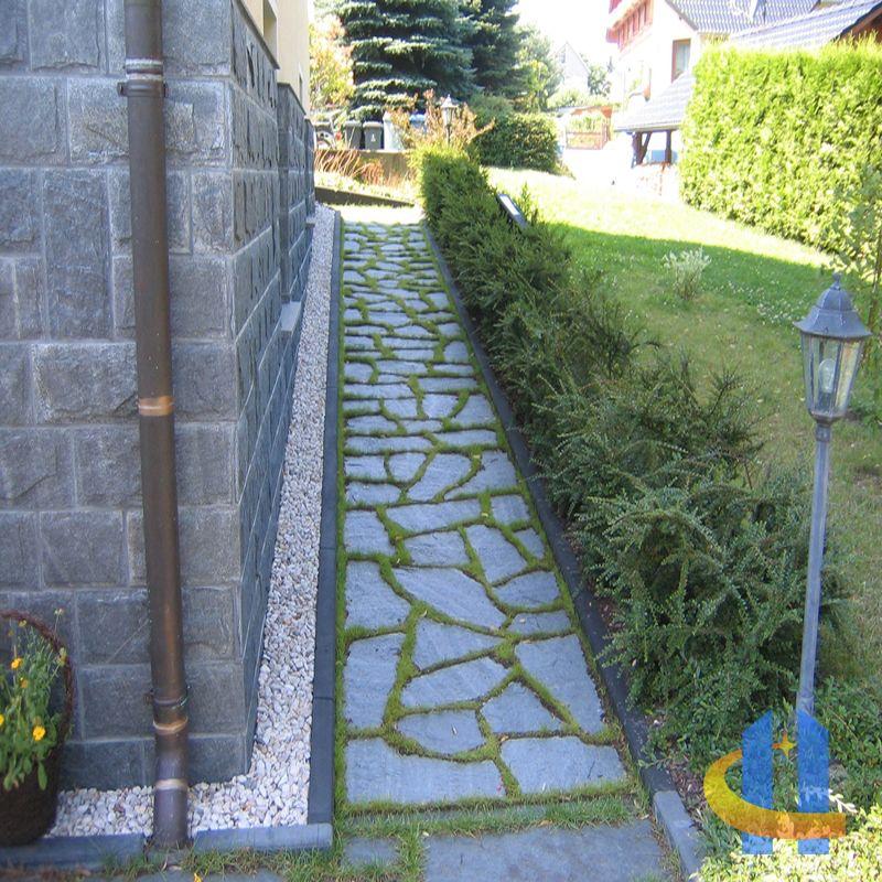 Terrasse aus naturstein polygonalplatten mit rasenfugen Natursteine garten