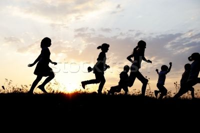 Stock Photo Silhouette Group Of Happy Children Playing On Meadow