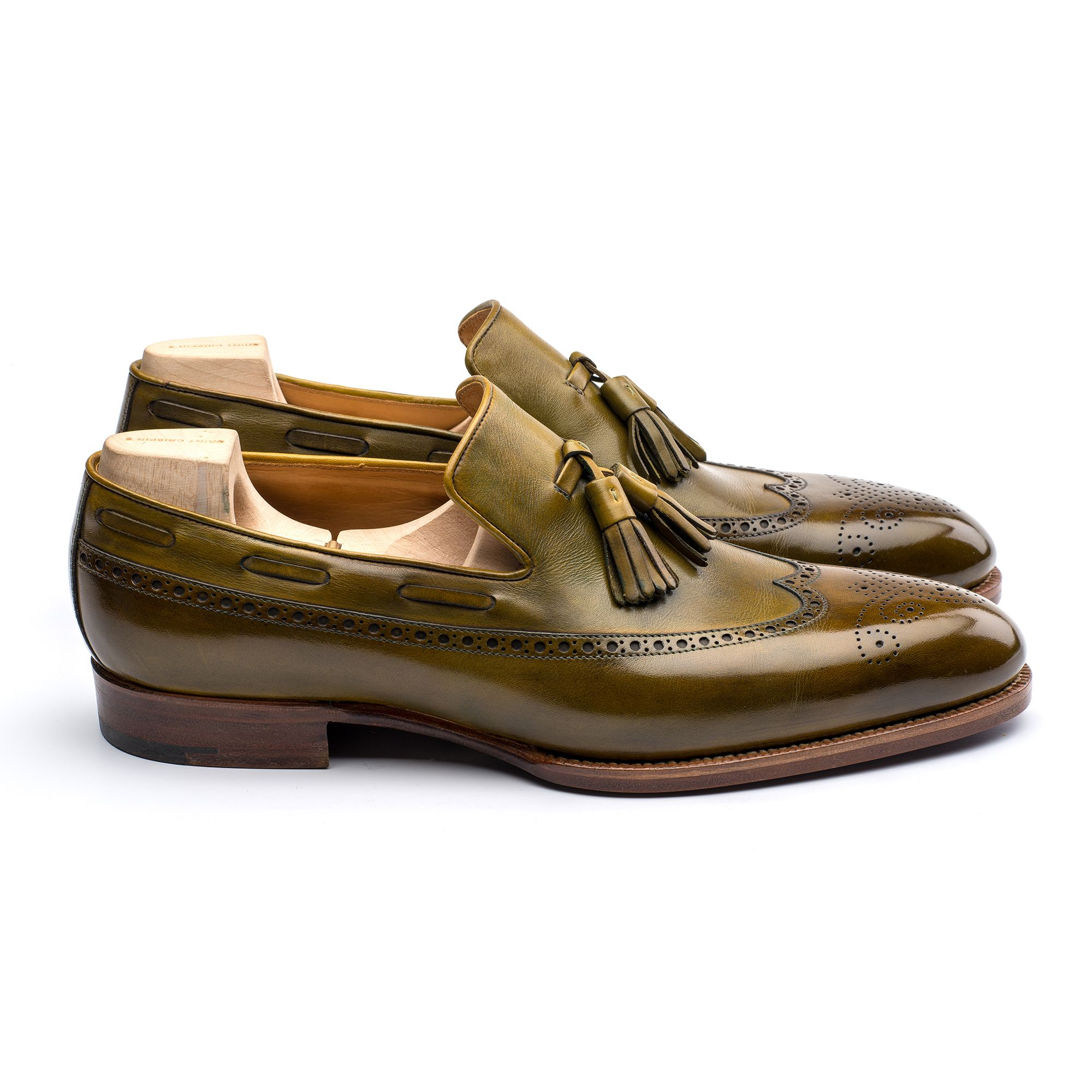 e12b714acf5 Combining the full brogue detailing of long wing oxfords and the casual  elegance of tassel loafers
