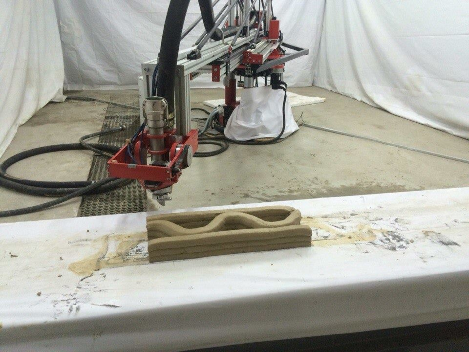 Apis Cor Mobile 3D House Printer prints while remaining inside of