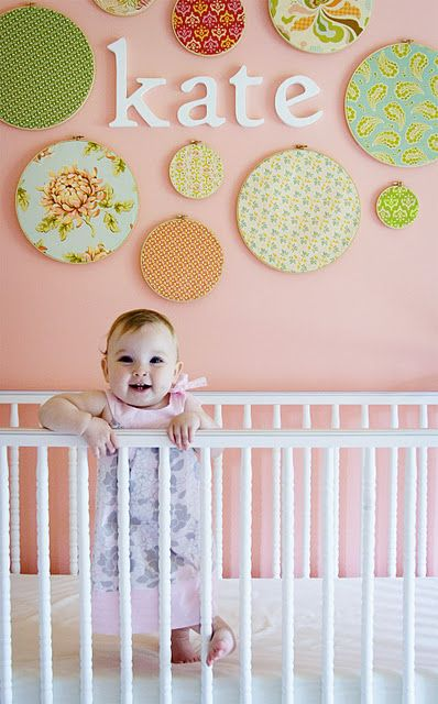 cute nursery wall (or any bedroom wall) using embroidery hoops and fabric.