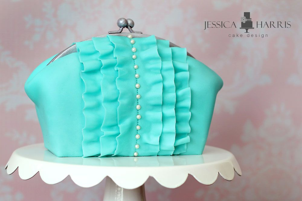 Learn how to make this simple, chic clutch purse cake for your next party!