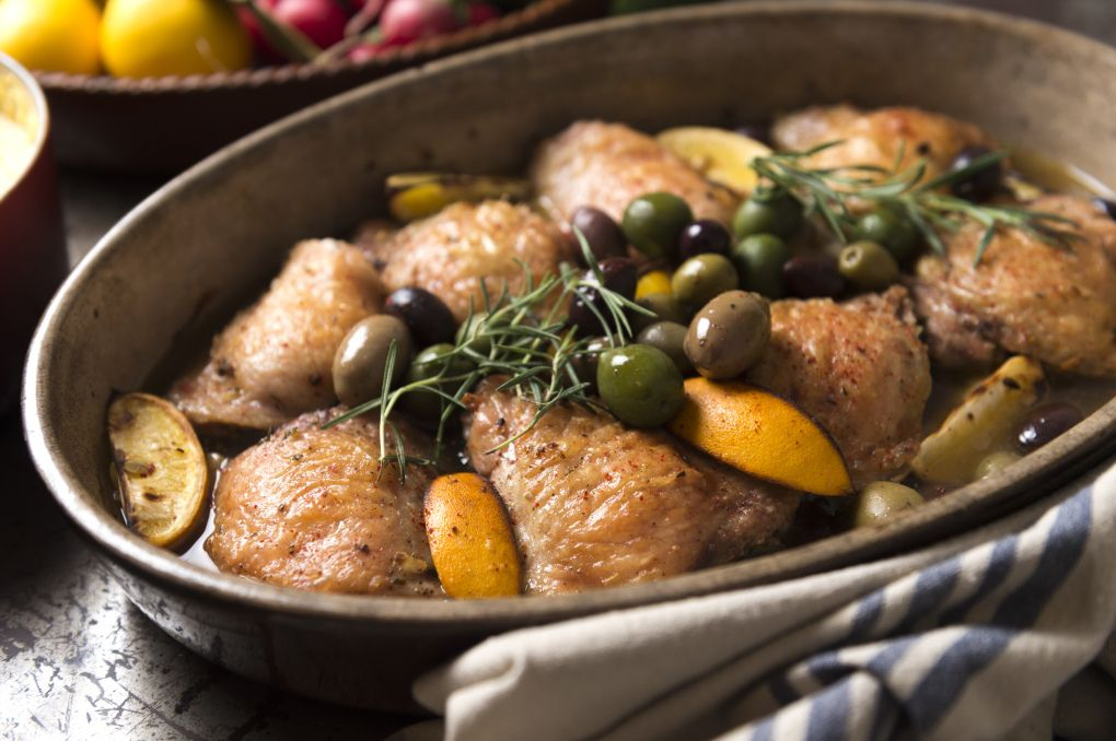 Braised chicken thighs with lemon and olives is earthy, herbaceous, lemony. (EVAN SUNG/NYT)