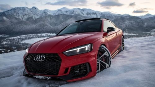 2018 Audi Rs5 Comes Out To Play In The Snow Looks Stunning In Red Audi Rs5 Red Audi Audi Cars