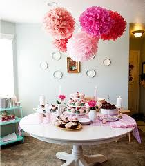 These giant tissue paper flowers would look fab hanging from the ceiling in a girls room. Also great for parties!