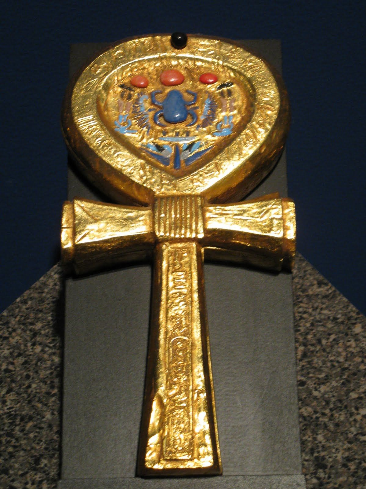 Gilded wooden mirror case in the shape of an ankh emblem of king gilded wooden mirror case in the shape of an ankh emblem of king tutankhamun buycottarizona Images