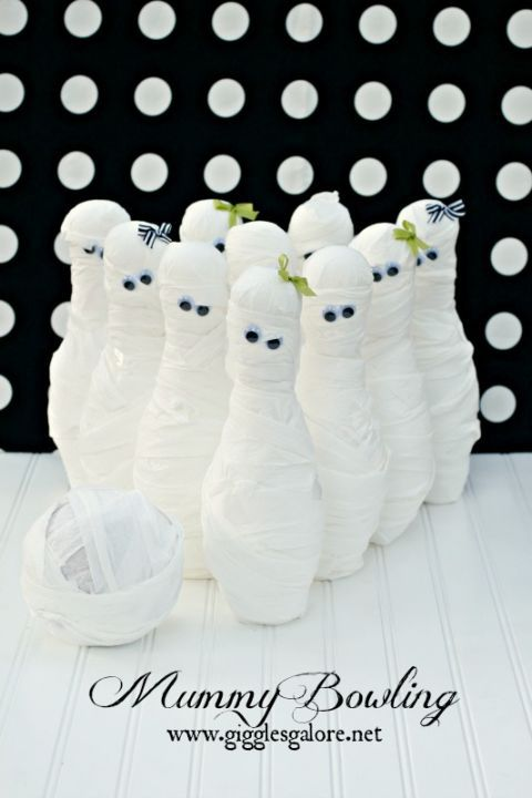 Go all out this Halloween and adapt your guests' favorite games into Halloween hits. Wrap store-brought bowling pins with toilet paper and add googly eyes to make marvelous mummies ready to be knocked over.