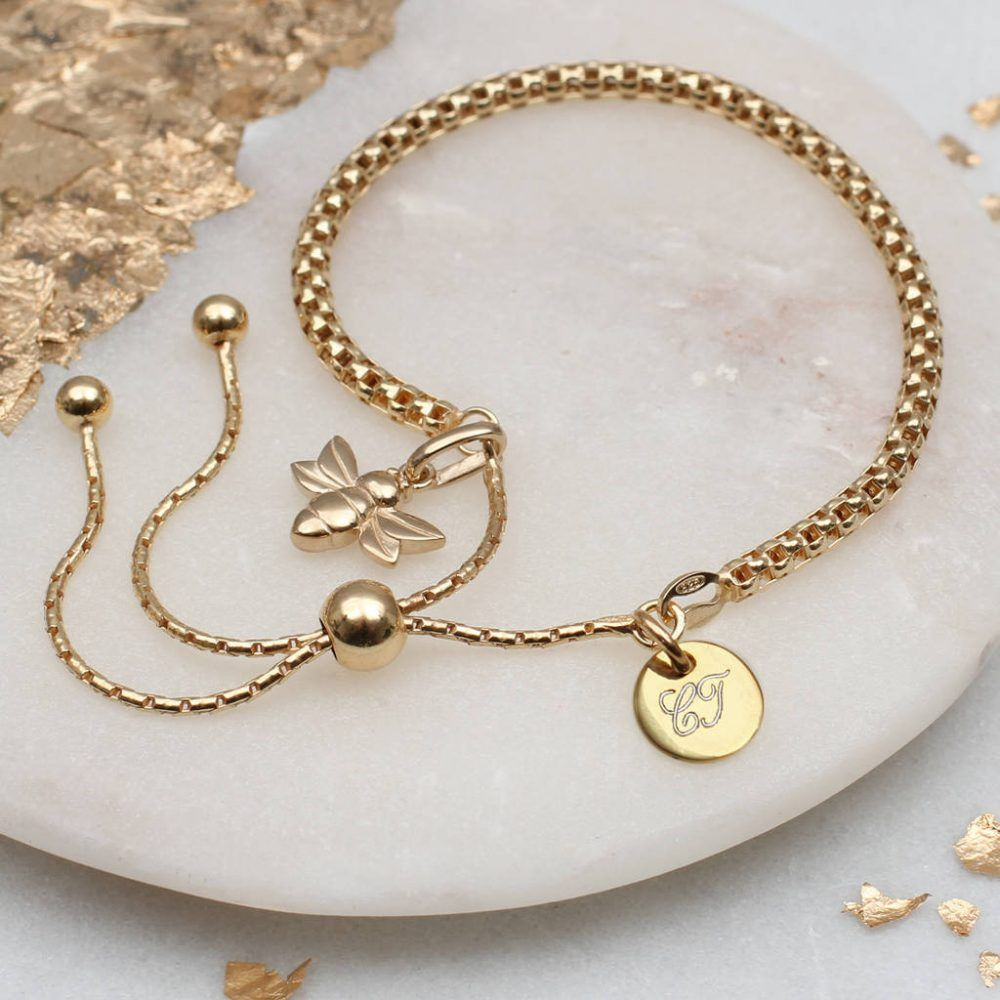 316e44bd3353 A beautiful gold mini bee bracelet personalised with your choice of  initials on a gold mini