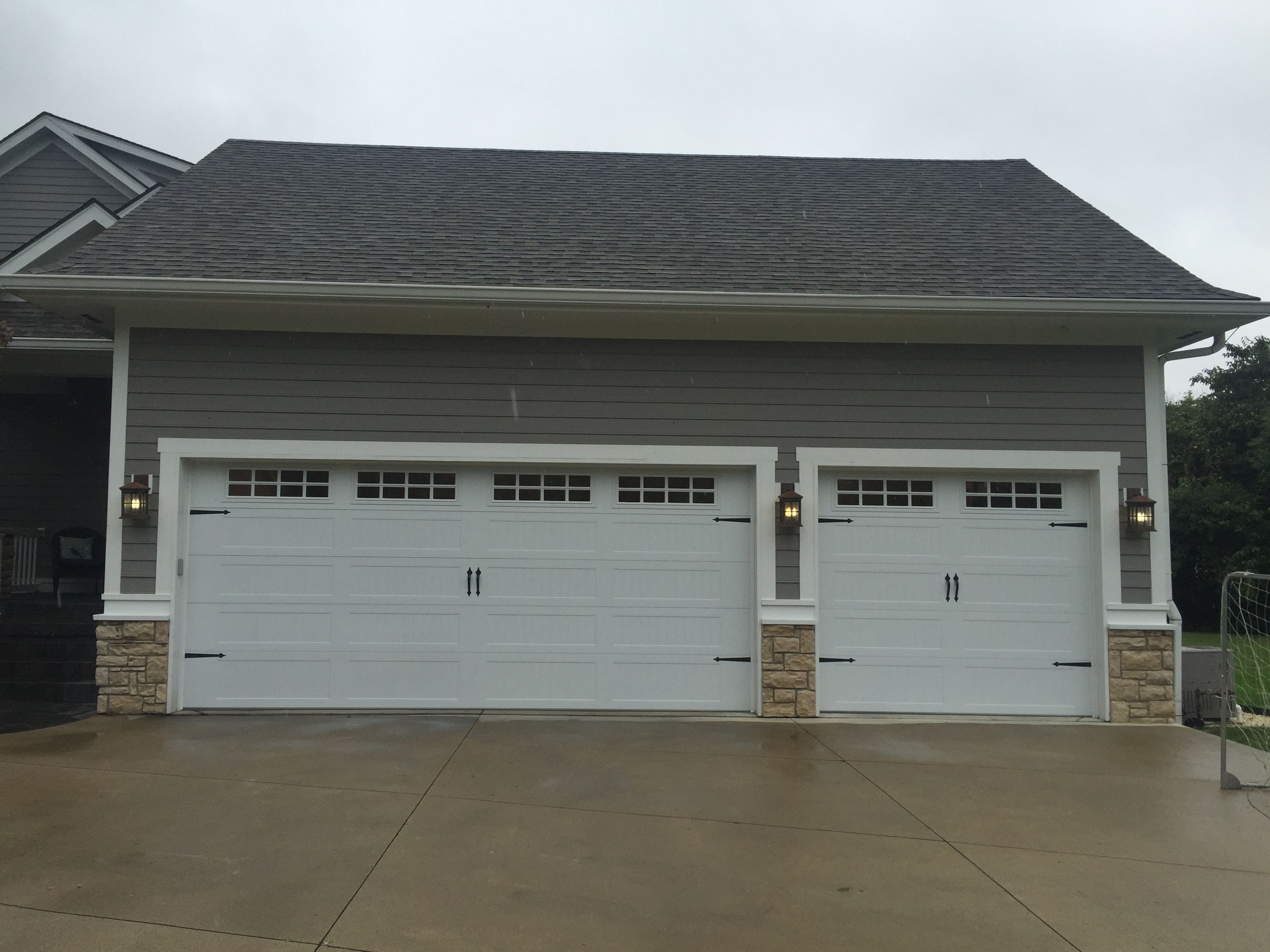 Beautiful chi model stamped carriage house garage doors with