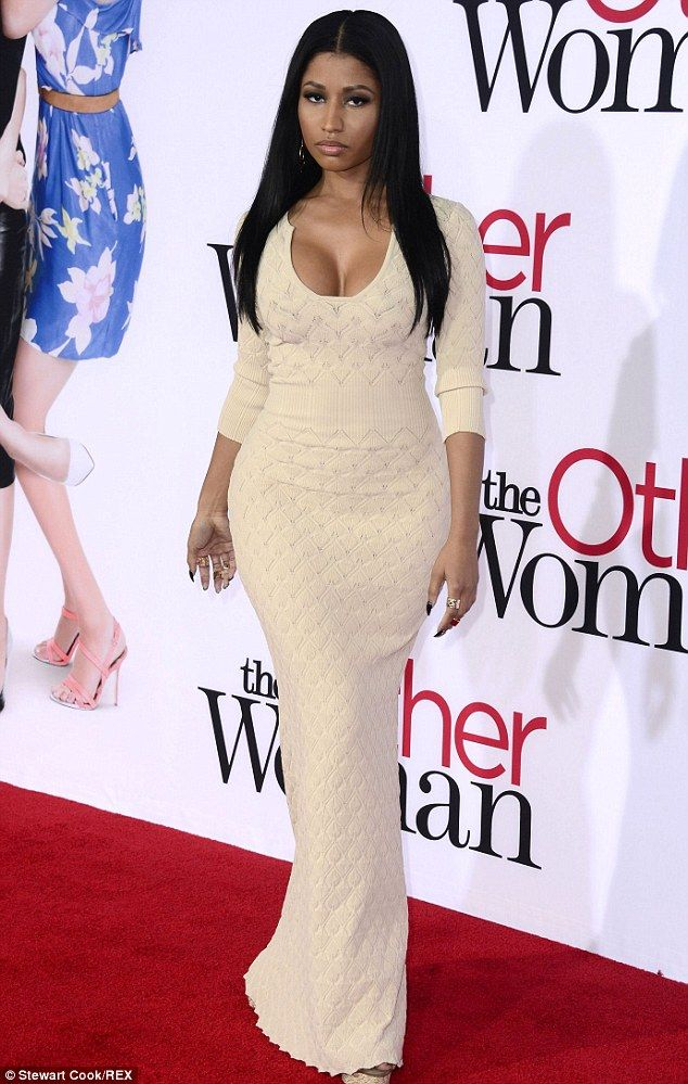 Nicki Minaj swaps outlandish style for conservative but low-cut ...