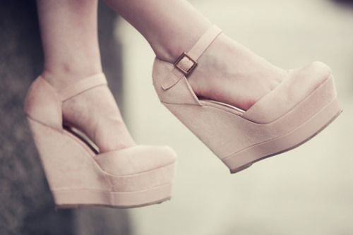 Nude ankle strap wedges.