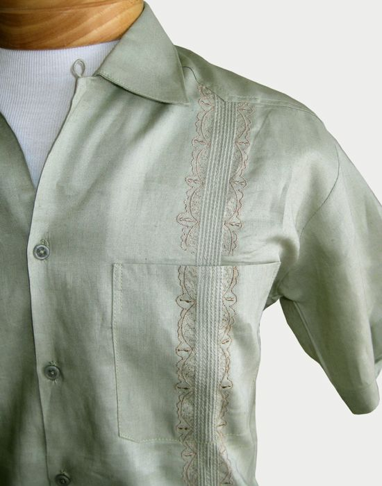 15958a7edb Close-up of one of our men s linen Guayabera shirts