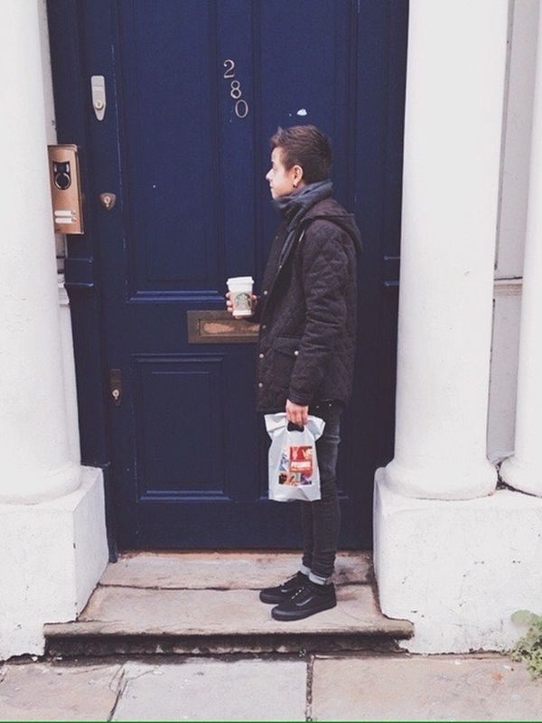 Outside The Blue Door, Starbucks in my hand, souvenirs in my bag.