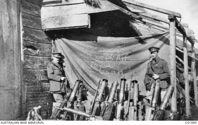 Lieutenant Colonel Frederick George Woods and Major Eric William Stutchbury MC and bar, both smoking pipes, with some of the German Maxim 08 machine guns captured by the 55th Battalion in the attack near Ypres by the 5th Division...