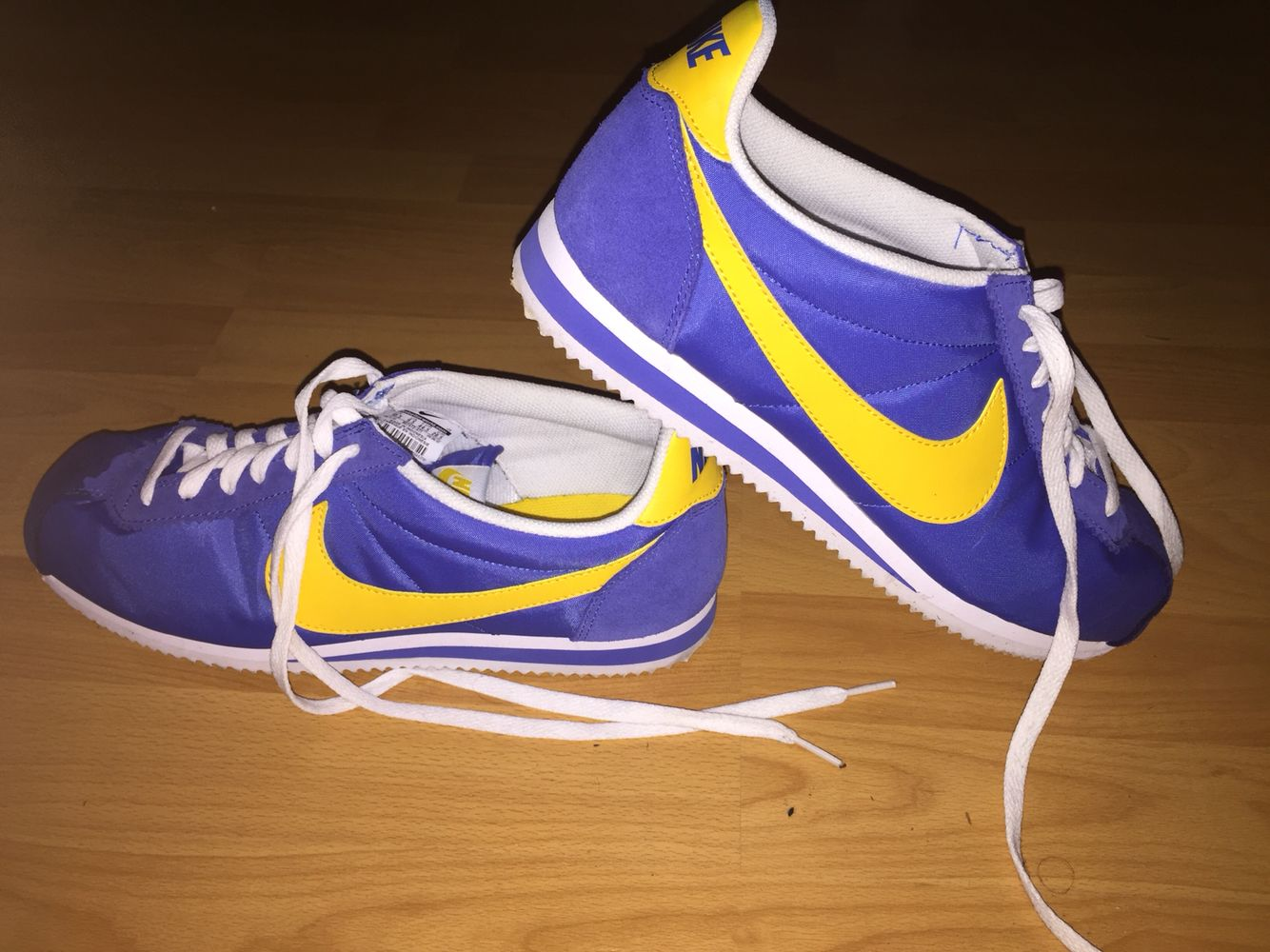 yellow and blue nike cortez
