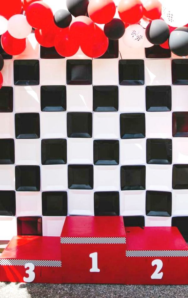 WOW!! Love the photo booth at this race car birthday party!  See more party ideas and share yours at CatchMyParty.com #catchmyparty #partyideas #racecar #racecarparty #Speed #boybirthdayparty #photobooth