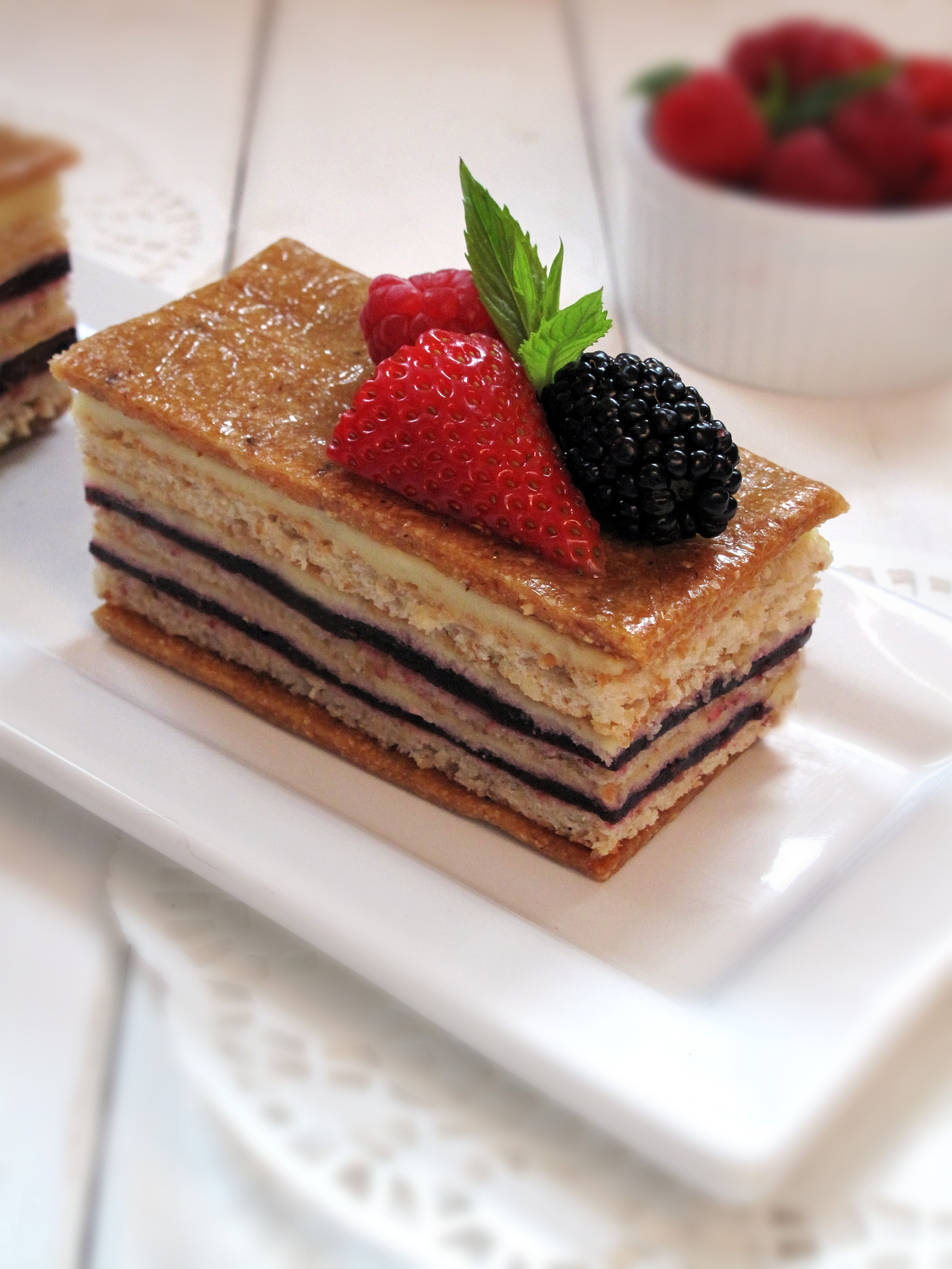 Raspberry hazelnut torte with vanilla-chive pastry cream, hazelnut dacquoise, and hazelnut nougatine #food #foodporn #cake