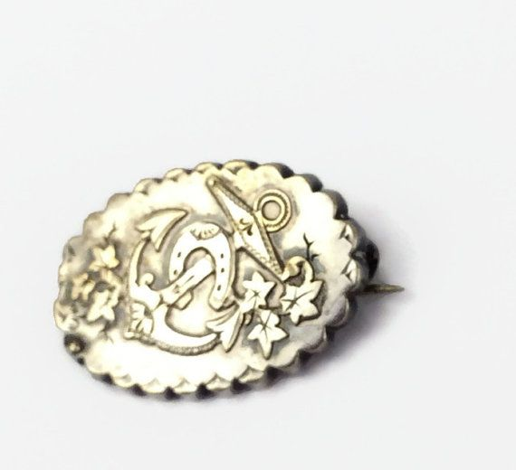 Victorian sterling silver brooch with anchor horseshoe ivy motif hallmarked