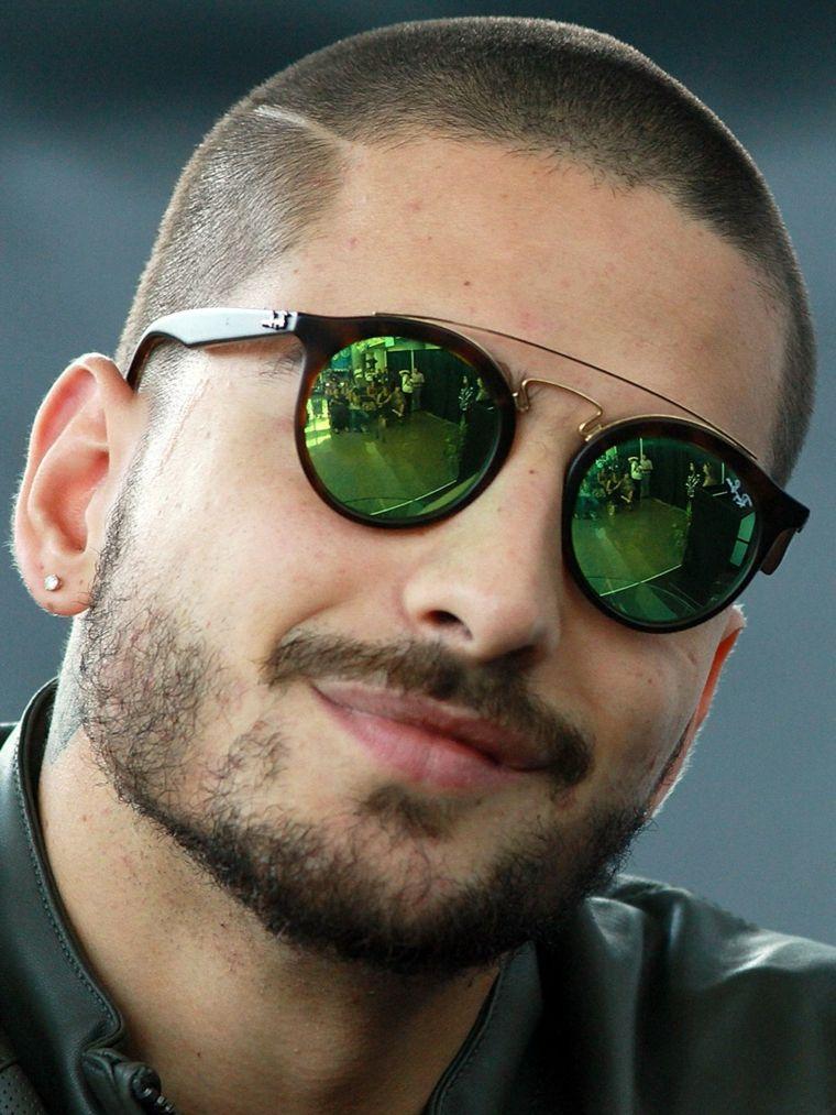 enorme sconto 3bd00 0e875 Il cantante Maluma, ragazzo con occhiali da sole, tagli ...