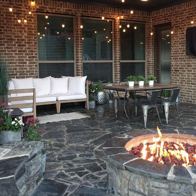 Brick home with industrial inspired porch and outdoor firepit. Home Bunch's Beautiful Homes of Instagram Pillow Thought