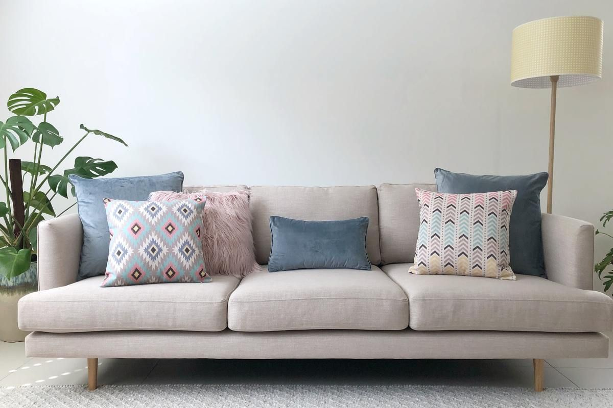 Grey Sofa With Pastel Cushions In Pink Grey And Blue Cushions On Sofa Grey Couch Living Room Couches Living Room