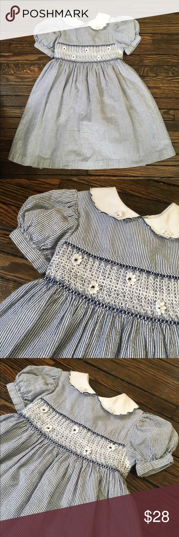Vintage B.t. Kids Navy White Smocked Girl Dress 2T Vintage girl's dress with sash tie, buttons in back, and smock along the neckline. The dress is lined and comes in a size 2 Toddler by B.t. Kids and is smoke free. Adorable with no damage or wear and tear. The cute dainty flowers need ironing but are all intact. Lovely vintage piece for your babe. B.t. Kids Dresses