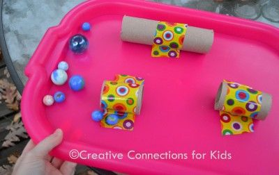 Tape toilet paper rolls to a tray, add marbles and try to get them to roll trough. Great motor skills for the kiddos.
