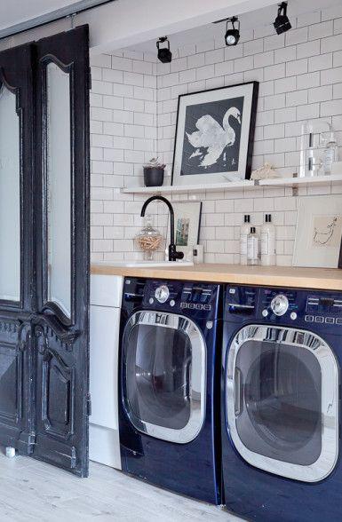 Hidden laundry room behind antique sliding doors eclecticallyvintage.com