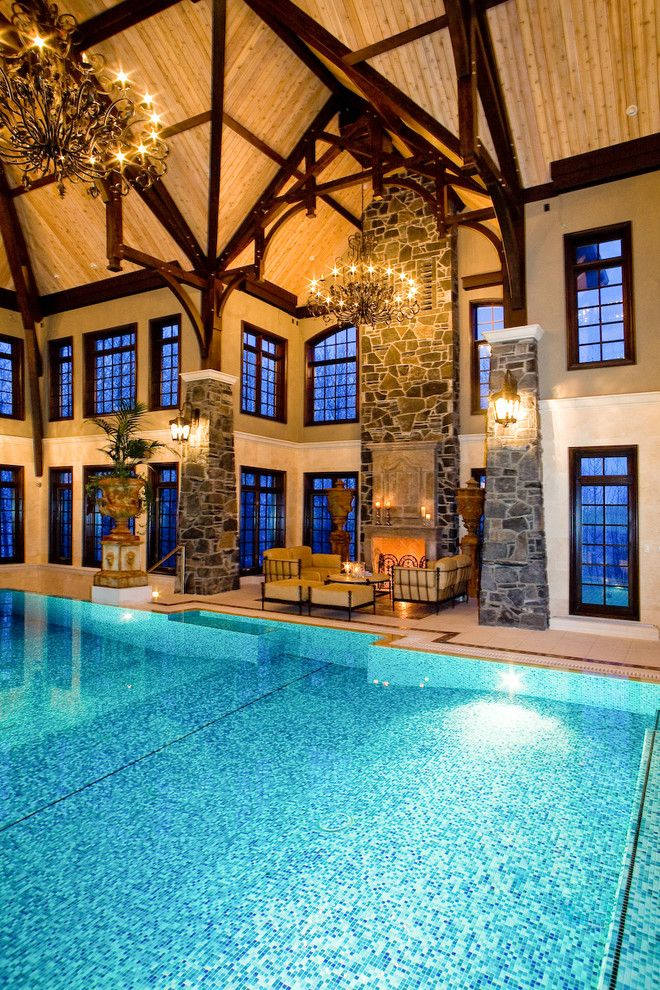 Indoor pool poolside seating chandeliers wooden ceiling windows wall indoor pool poolside seating chandeliers wooden ceiling windows wall lamps fireolace low table of indoor pool aloadofball Choice Image