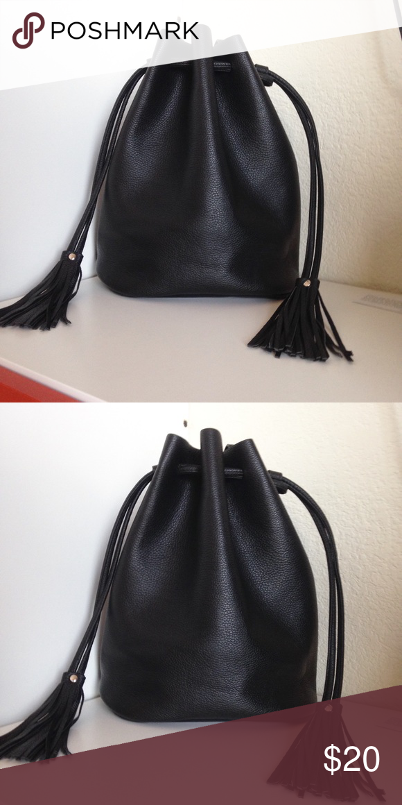 78404a8313e1 H M Bucket Bag In excellent condition. In grained imitation leather with a  shoulder strap and a drawstring at the top with tassels on the ends.  Unlined.