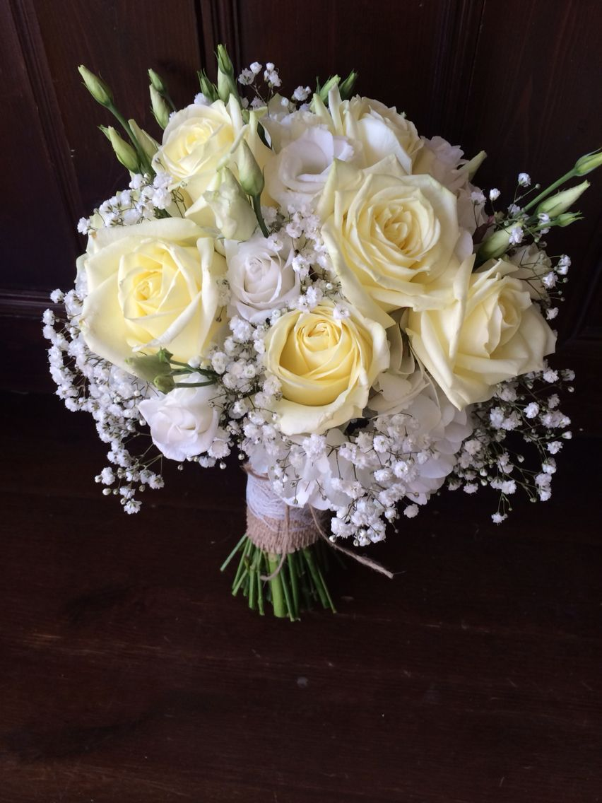 Brides Bouquet Of Hydrangea Roses Lisianthus And Gypsophilia