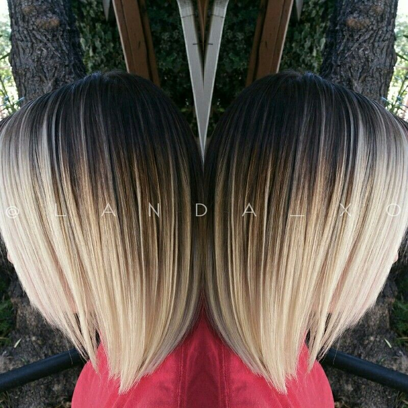 A Contrasty Dark Root To Platinum Blonde Ombre With Balayage