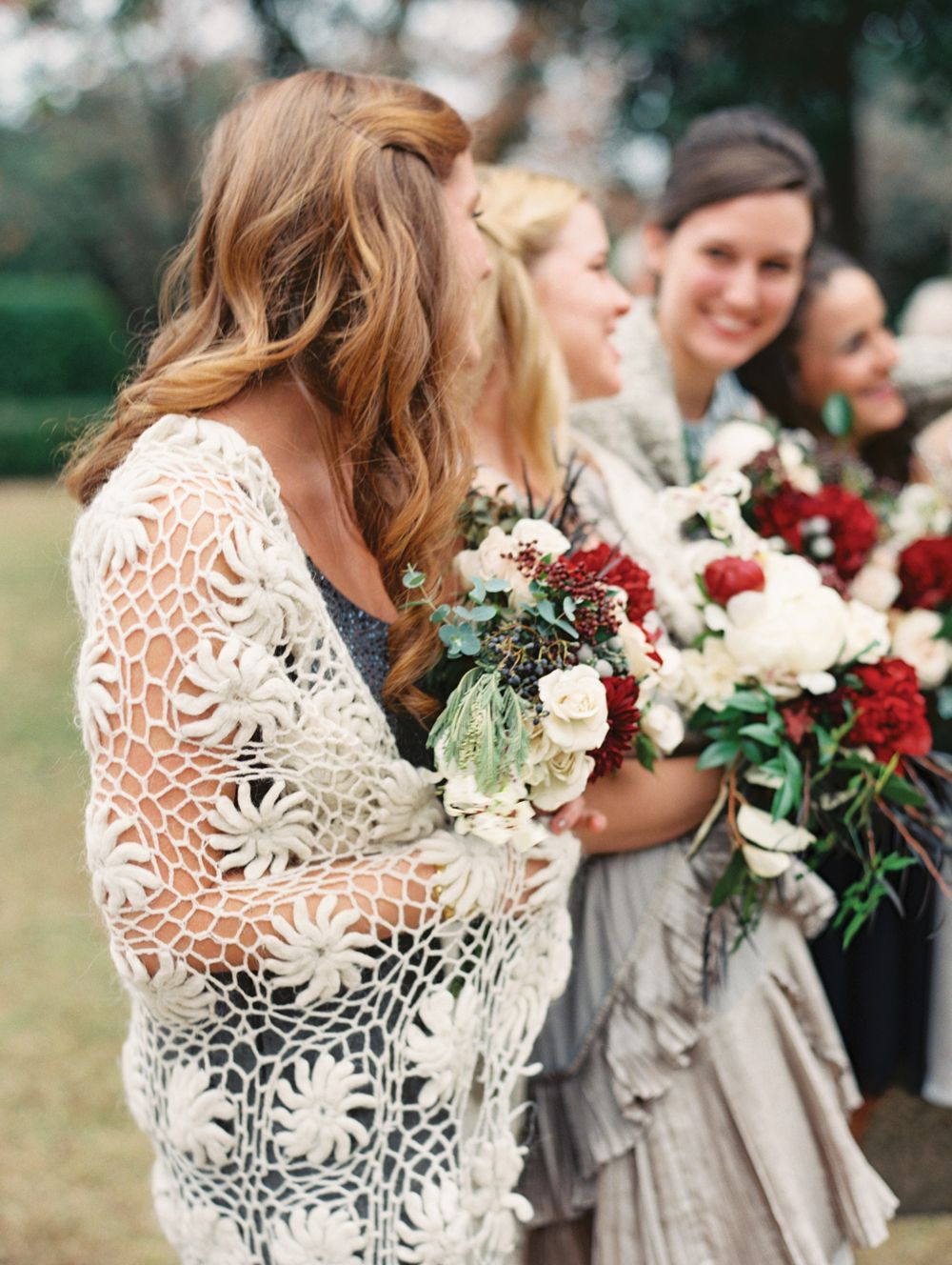 Autumn bridesmaids with beautiful knit wrap dresses in a variety of