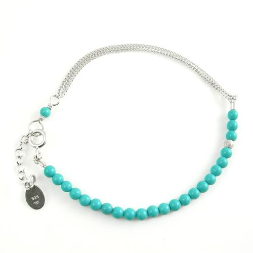 Sterling silver friendship bracelet with turquoise beads.