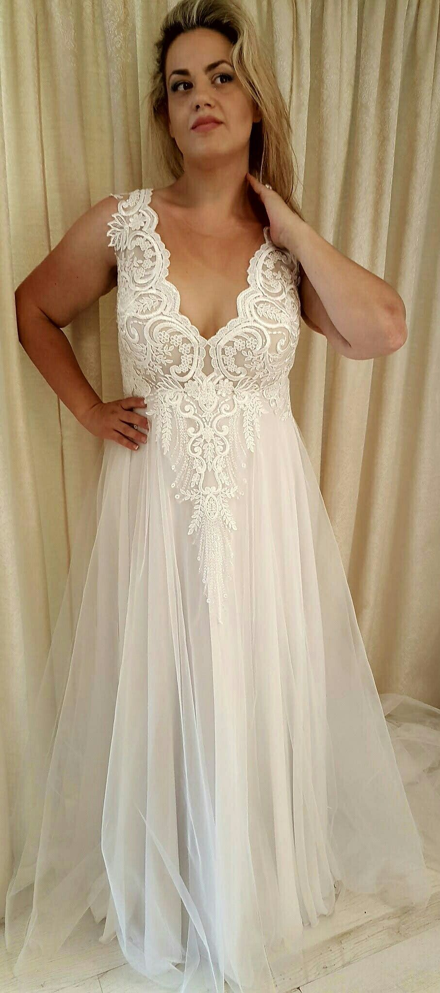 e34fc0aae465 Breath taking plus size wedding dress from Studio Levana 2018 curvy  collection. Tracie curvy wedding gown with a shimmering lace top and a  tulle skirt