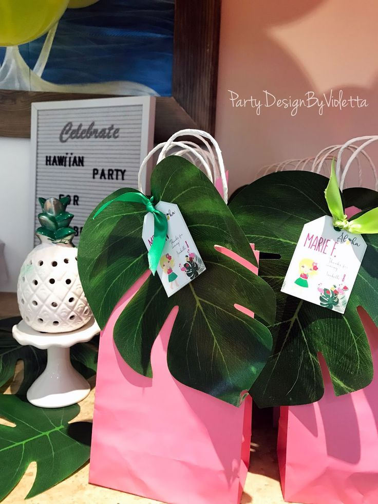 Aloha! Hawaiian Luau Party + A Tropical celebration for Isabelle Tropical goodie bags with monstera leave and cute custom labels all about detail you can find labels at my Etsy Shop @PartyDesignByV #hawaiianluauparty