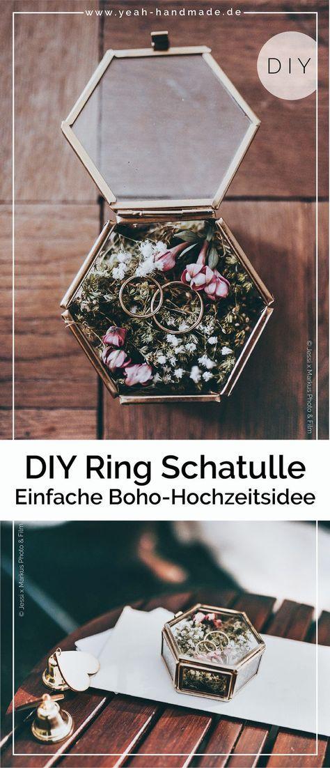 Ideas de boda DIY: almohada de anillo hecha de musgo en una caja de vidrio