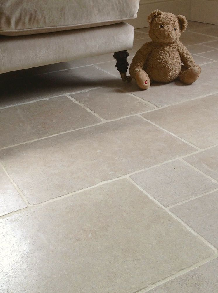 Cathedral Antique Tumbled Limestone Floor Tile Sample In Home